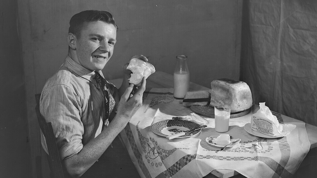 Enjoying sunnywest butter, SW Co-op Dairy Products Ltd 1934