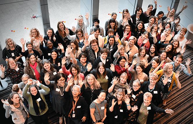 Large group of women waving at camera - aerial photo