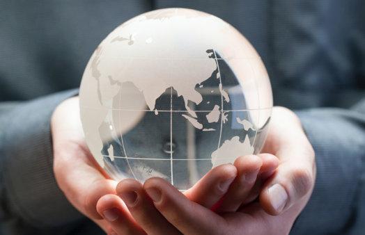 hands holding globe - Bill Oxford, Unsplash